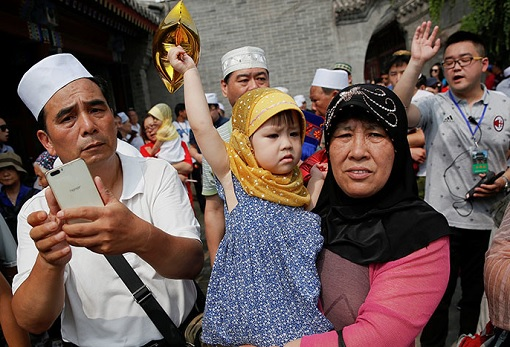 Uighur Muslim Family with Daughter in Xinjiang