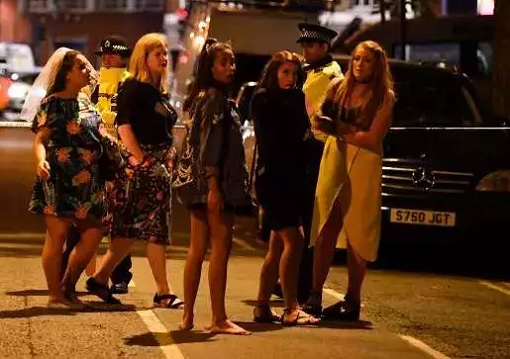 London Bridge and Borough Market Terror Attack - Women Stand at a Police Cordon