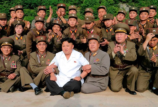 Kim Jong-un flanked by Military Personnel
