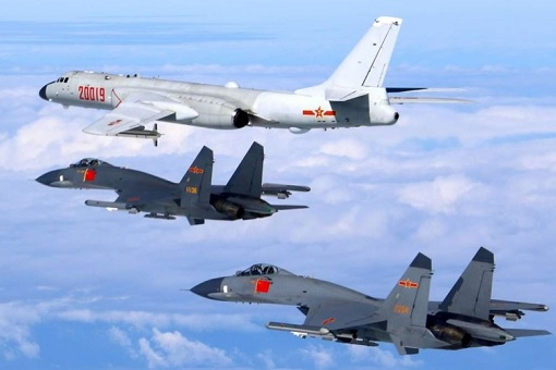 China H-6K Bomber Escorted by Fighter Jets