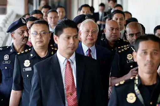 Najib Razak Charged For Criminal Breach of Trust - Escorted by Police