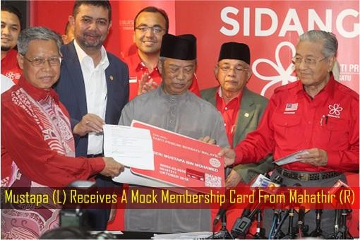 Mustapa Receives A Mock Membership Card From Mahathir