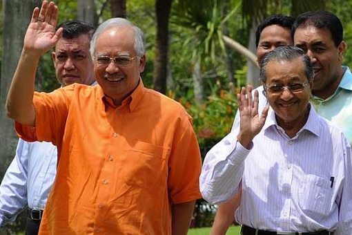 Najib Razak with Mahathir Mohamad - Happily Waving and Smiling