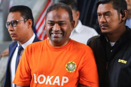 Abdul Azeez Abdul Rahim - MACC Orange Suit LockUp