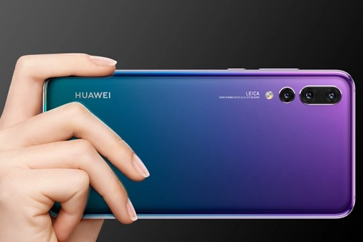 Holding Huawei Smartphone