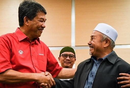 UMNO-PAS Marriage - UMNO Acting President Mohamad Hasan and PAS deputy president Tuan Ibrahim Tuan Man