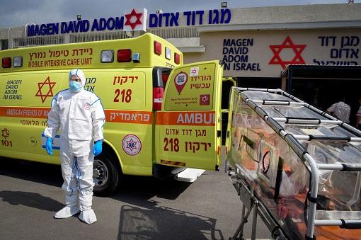 Coronavirus - Israel - Transporting Patient Into Ambulance