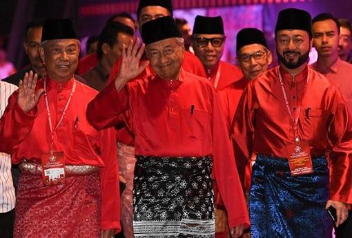 Muhyiddin Yassin and Mahathir Mohamad and Mukhriz Mahathir