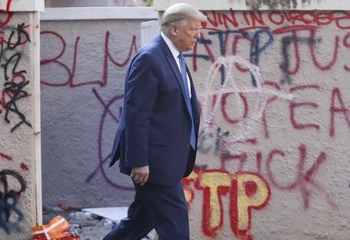 US Race Riots - President Donald Trump Walks Passed Vandalism