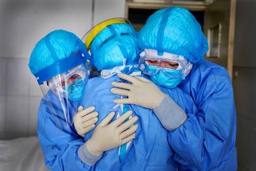 Coronavirus - Healthcare Workers Hugging