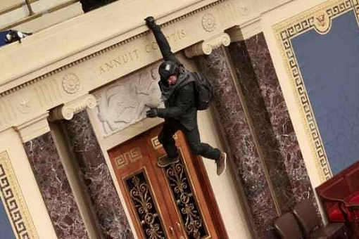 US Capitol Riot Photo - A protester Dangled from the Balcony in the Senate Chamber