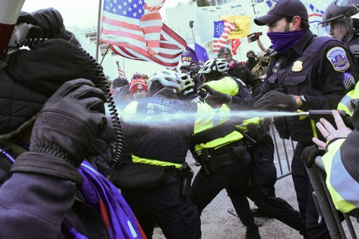 US Capitol Riot Photo - Police Clash with Trump Protesters Trying to Access the Capitol Building