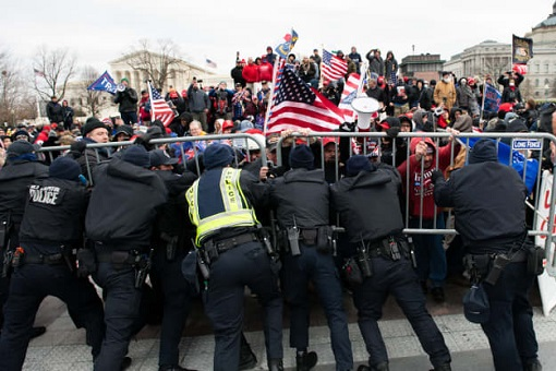 US Capitol Riot Photo - Police Try to Hold Protesters Back