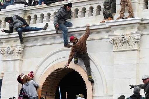 US Capitol Riot Photo - Protesters Climb walls of the Capitol