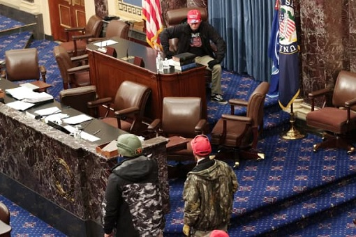 US Capitol Riot Photo - Protesters Take Control Of The Senate Chamber