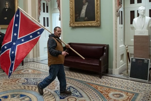 US Capitol Riot Photo - Trump Supporter Carries Confederate Flag Inside Capitol