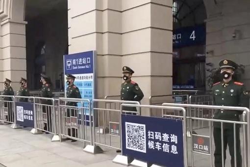 Coronavirus - Wuhan Lockdown - Police Guard