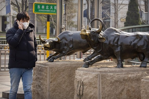 China Stock Market - Young People Passing A Bull Statue